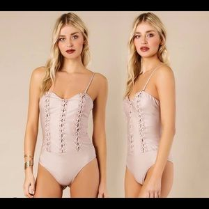 Sexy Body Suits available in nude and white